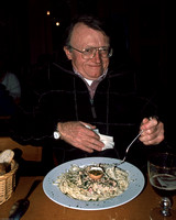 Father Bob eating pasta in Ghent