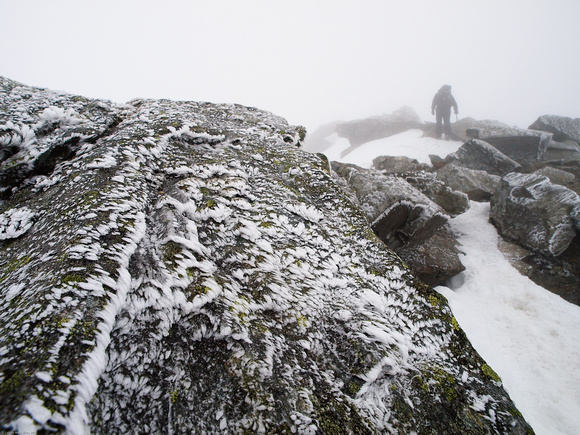 Rimed rocks, with Garth approaching the summit