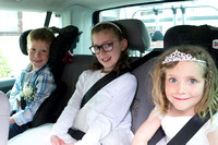 Excited children heading off for the wedding